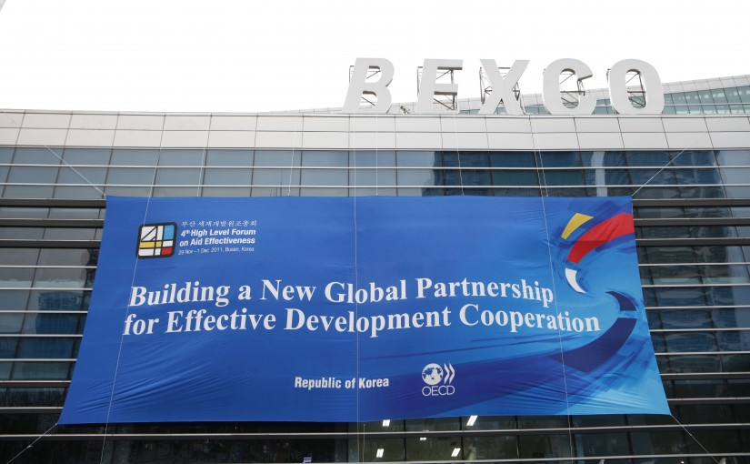 The logo of the High Level Forum, hanging on the side of the conference centre