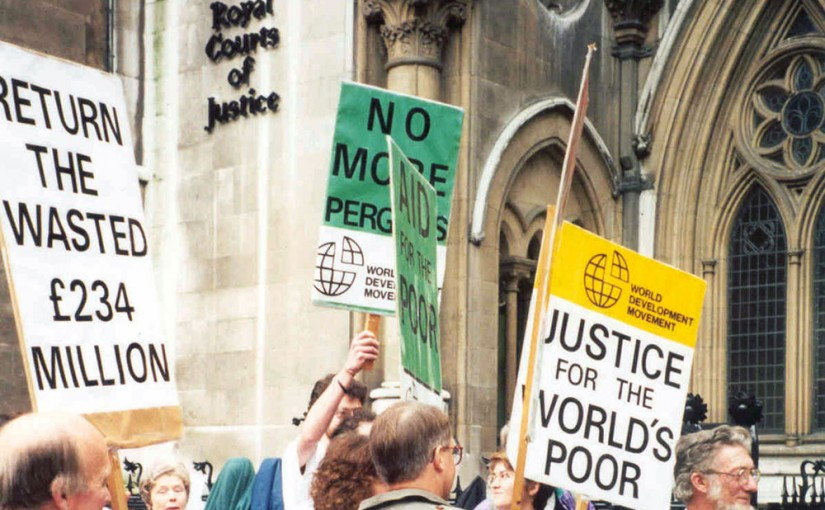 Protesters with placards outside the UK High Court, 1994