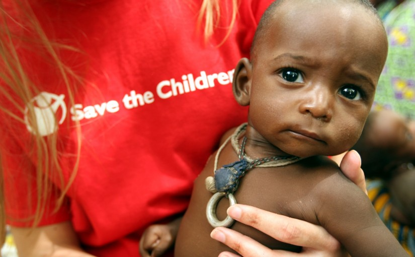 Save the Children UK staff member, Susannah Parker, holds seven month-old Abdou Bassinou at Bande feeding centre