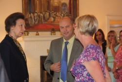 Jill Campbell receives her MBE from Princess Anne.