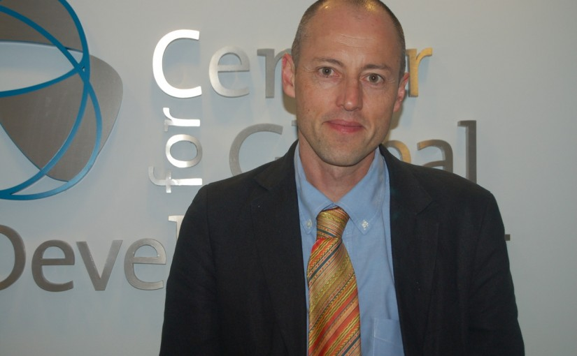Owen Barder in front of the CGD logo