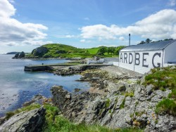 The sun shines on Ardbeg distillery warehouse