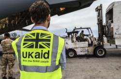 A DFID staff member supervises the unloading of UK Aid  from a RAF C-17 aircaft  in Kathmundu Nepal on the 29 April 2015.  Commissioned by the Department for International Development.The flight is carrying vital UK Government aid stocks to Nepal, including shelter kits and solar lanterns.   Images By Sgt Neil Bryden RAF
