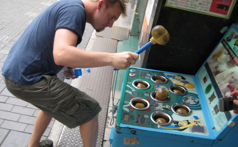 om playing Korean Whack a Mole in Insadong Seoul Korea.
